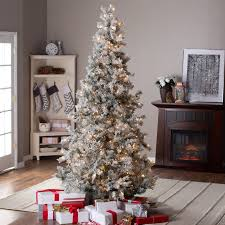 7 5ft pre lit lightly flocked whiteland pine w laser glitter