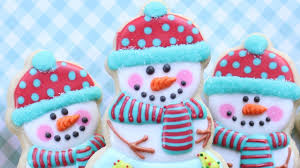 christmas or holiday cookies snowman cookies with a snow globe