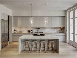kitchen white cabinets with dark granite dark floors white