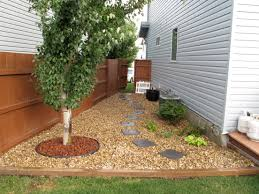 Backyard Gate Ideas Narrow Side Yard House Design With Brown Gravels And Wooden Fence