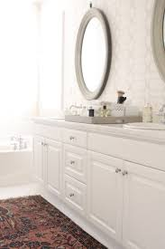 gray oval vanity mirrors transitional bathroom owens and davis