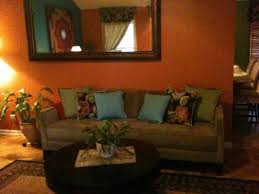 living room furniture in brown color and orange ottomans 17