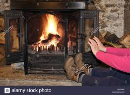 england uk person wearing boots warming cold hands and feet sat