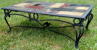 wrought iron coffee table with glass and wooden round