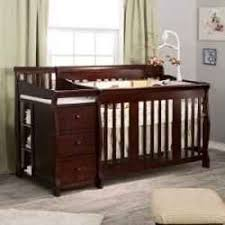 cribs with changing table and storage a perfect solution for a small nursery a crib changing table combo