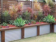 Corrugated Metal Planters low corrugated iron u0026 wood retaining wall would look great in an