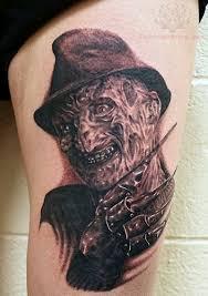 scary grey ink freddy krueger head tattoo on leg