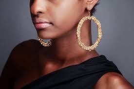 large gold hoop earrings pink velvet designs bigger is better gold or silver hoop