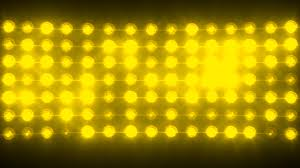 yellow bright wall of lights concert stage sports stadium