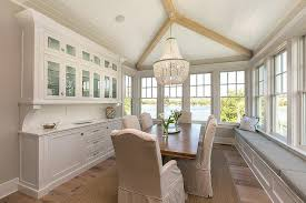 round white cottage dining table with white beaded chandelier