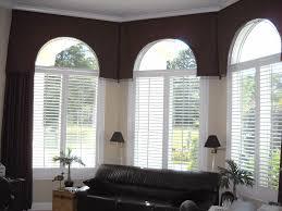 home design palladian window with dark leather sofa also wooden