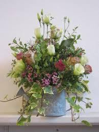 watering can with rustic mixed flowers floral design