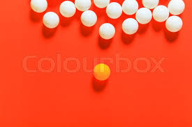 orange and white balls think different concept or leadership