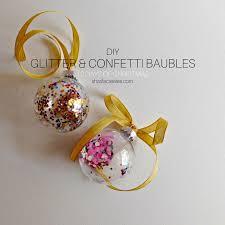 diy glitter and confetti baubles sharifa creates