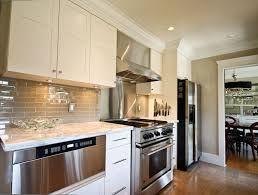 white kitchen cabinets with taupe backsplash southlands residence cultivate taupe kitchen white