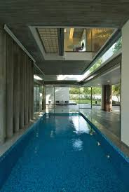 indoor pool glass walls poona house in mumbai india by rajiv