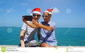 Happy Couple Wear Santas Hat Making Selfie With Smartphone On The