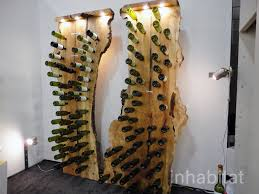 fallen tree wine rack holds a wine collection of epic proportions