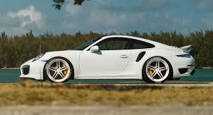 porsche 911 white white porsche 911 turbo s kicks back on adv 1 wheels
