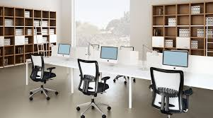 interior long white computer desk and comfy swivel chairs in