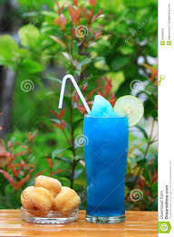 blue hawaiian cocktail blue hawaiian cocktail with dessert stock photo image 25999916