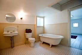 bathroom laminate tile flooring with wood baseboard and cozy