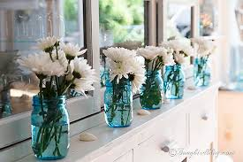 decorating ideas with blue jars and flowers