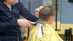 barber cut hair of the boy with a haircut machine youtube