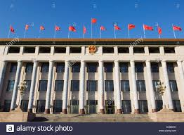 chinese national flags on a government building tiananmen square