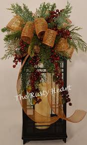 mesh ribbon table decorations this swag is decorated with mesh bronze ribbon various greens and
