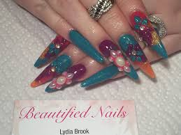 acrylic nails long stiletto sculpted nails using crystal nails