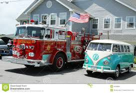 new volkswagen bus fire truck and 1966 volkswagen bus vanagon on display editorial