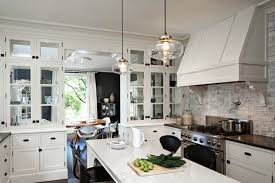 imaginative white kitchen design with brown stained wood floors