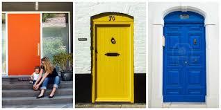100 yellow house with blue door tone on tone storm doors