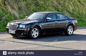 chrysler 300c black a black chrysler 300 sedan car parked on the roadside scarborough