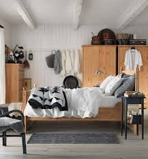 bedrooms wooden bed frame rustic chair plant in pot motivated
