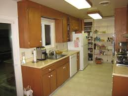 kitchen how to layout an efficient kitchen floor plan kitchen large size of kitchen brown kitchen cabinets stainless faucet electric stove tile flooring white refrigerator