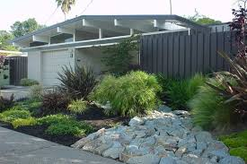 mid century exterior with nice slatted fencing mid century