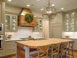interior rectangle chandelier with light wood kitchen island and