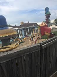 a house in my neighborhood has a burger king backyard playplace