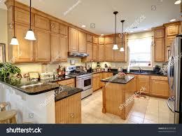 beautiful upscale kitchen maple cabinets stock photo 82107598