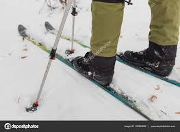 cross country skiing in winter woods close up of shoes and modern