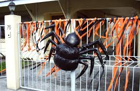 black spider decoration on railing fences outside part of
