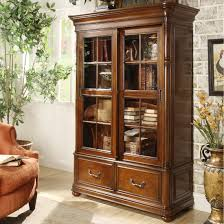 furniture height brown stained wooden bookcase with framed glass