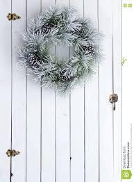 Pine Barn Door by Snowy Winter Christmas Wreath On A Barn Door Stock Photo Image