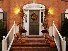 dark green shutters and beige paint with orange brick for the