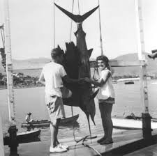 newlyweds john and jacqueline kennedy admiring the sailfish landed