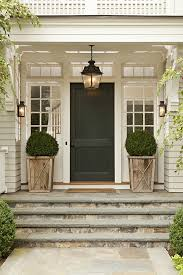 front porch white pots flanking each side stone steps door