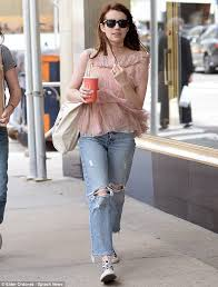 Blush Colored Blouse Emma Roberts Dons Ripped Denim And Pleated Blouse In Nyc Wstale Com