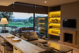 open concept living room in duplex at emporda golf resort by lory